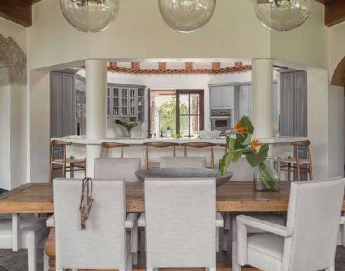Dining room and kitchen in background